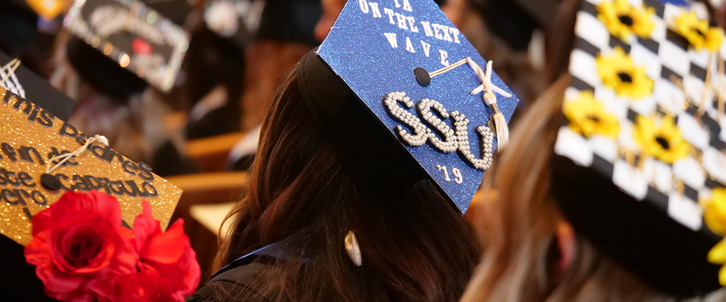 3 decorated mortar board caps